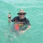 Tony cools off in the water with a refreshing beverage when we arrive at Anegada.