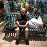 Tony with our shopping at the mall. He has discovered the one free wifi network in the plaza.