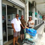 """Our rock-star parking was very handy to Tom's grocery store. Here we are leaving the store with our groceries in the """"chariot"""" (that's French for shopping cart / trolley)."""