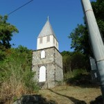 The bell tower of the Catholic church. It is separate from the church because of hurricanes: This way if the bell tower topples, the church is not damaged and vice versa.