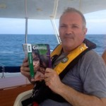 Tony reads up about Colombia while on the passage from Aruba.