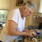 Here is my mother, hard at work, peeling the breadfruit. The skin is tough.