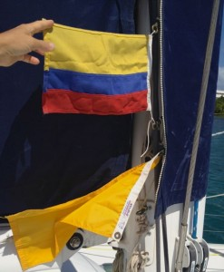 Down comes the Q flag and up goes the Colombian flag.