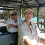Gayle and Pete in the golf cart.