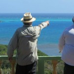 Tony and Pete at the lookout; discussing how they would bring On Delay in through the reef.