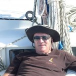 Drifting around Dolphin Bay 4: Tony lounges on the foredeck on his beanbag chair.