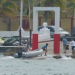 Gayle preparing to drag the dinghy out of the water.