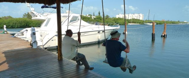 Pete and Tony try out the swings at the dock where we keep the dinghy.