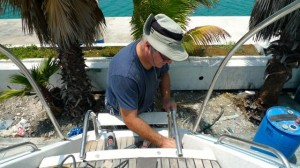 Tony works on the teak -- port side.