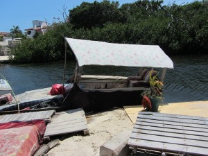 "A covered ferry travels the hundred yards between the ""main land"" and the island."