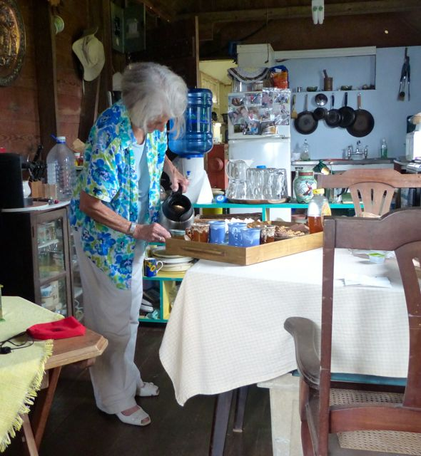 Mrs Twyman prepares coffee.