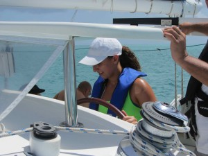 Watching the Chart Plotter, Uncle Pete shows Serena how to drive the boat.