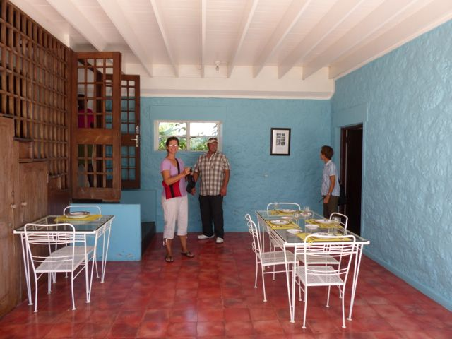 The dining room had walls on three sides. The fourth side opens out to the garden.