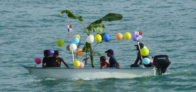 The balloon-decorated boat at the beach.