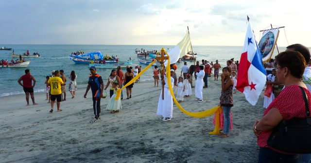 A religious procession at the beach.