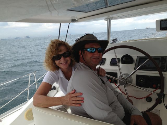 World-traveling mom and world-traveling son at the helm.