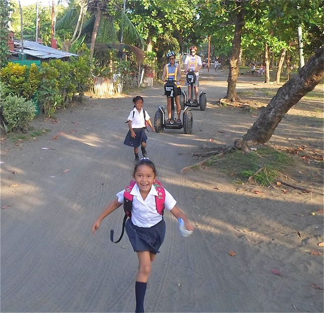School children are amused by gringos on Segways.