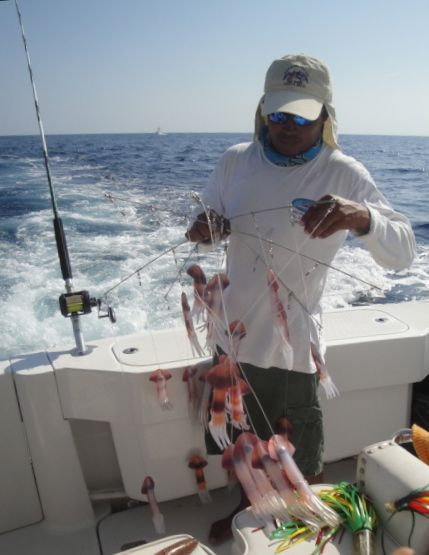 These are the teaser squid without hooks that get trailed behind the boat to attract but not catch the fish.